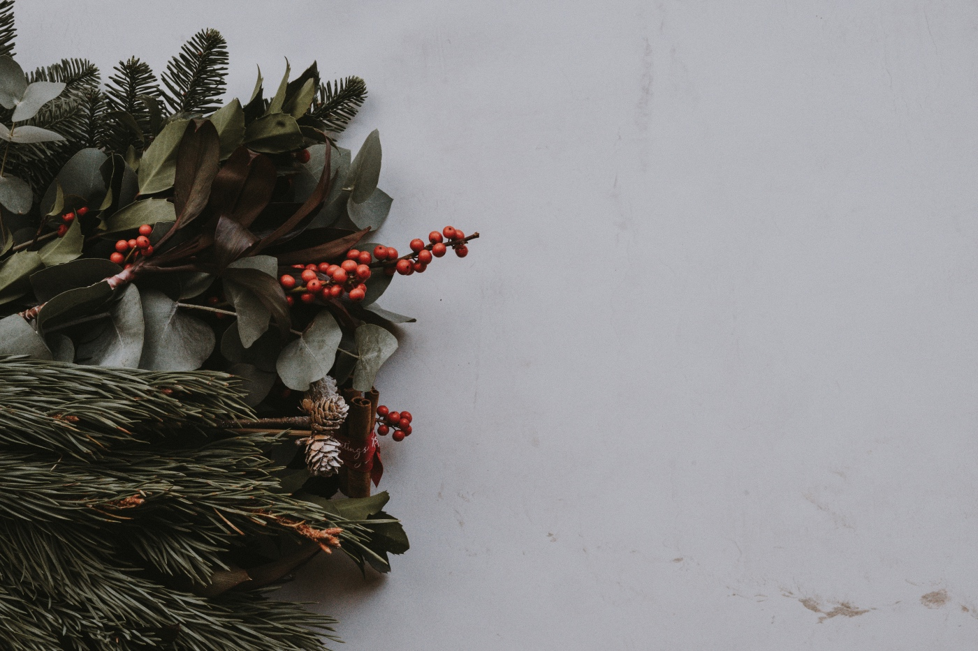 pinecones, pine, and greens to add to a winter bouquet of flowers