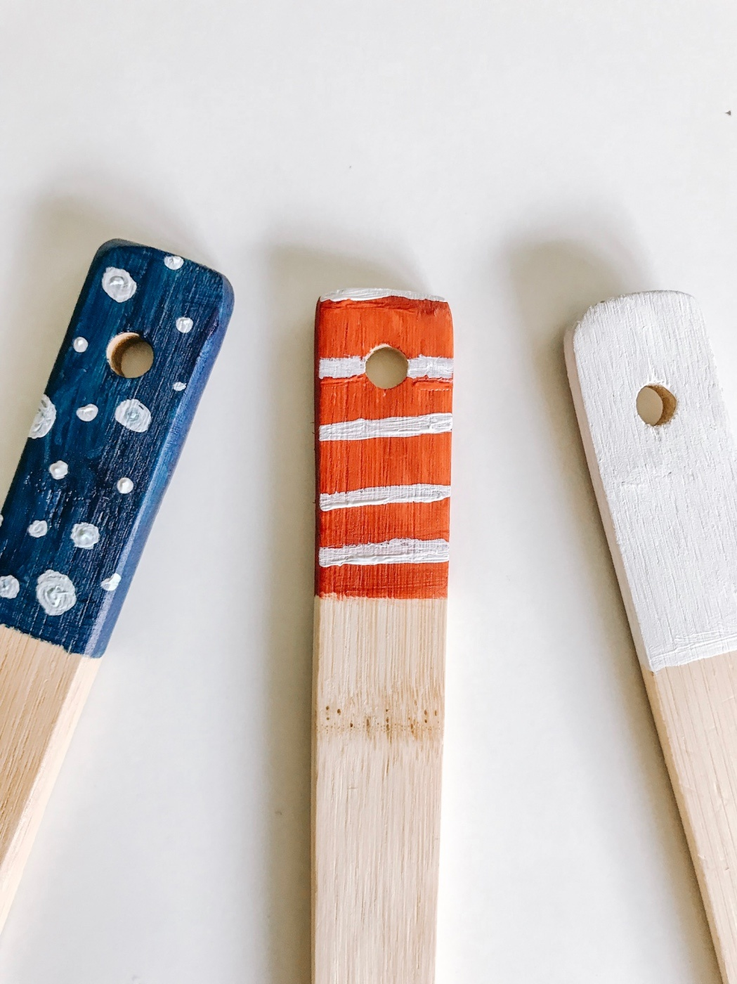 detail of unfinished polka dot and stripe kitchen spoons