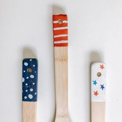 finished red, white, and blue painted kitchen utensils