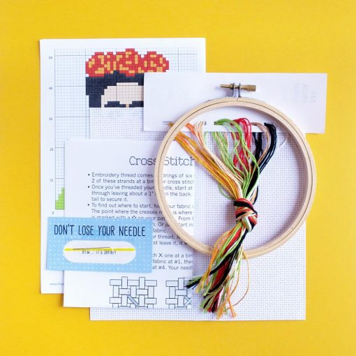 supplies inside the diy frida cross stitch kit pop shop america