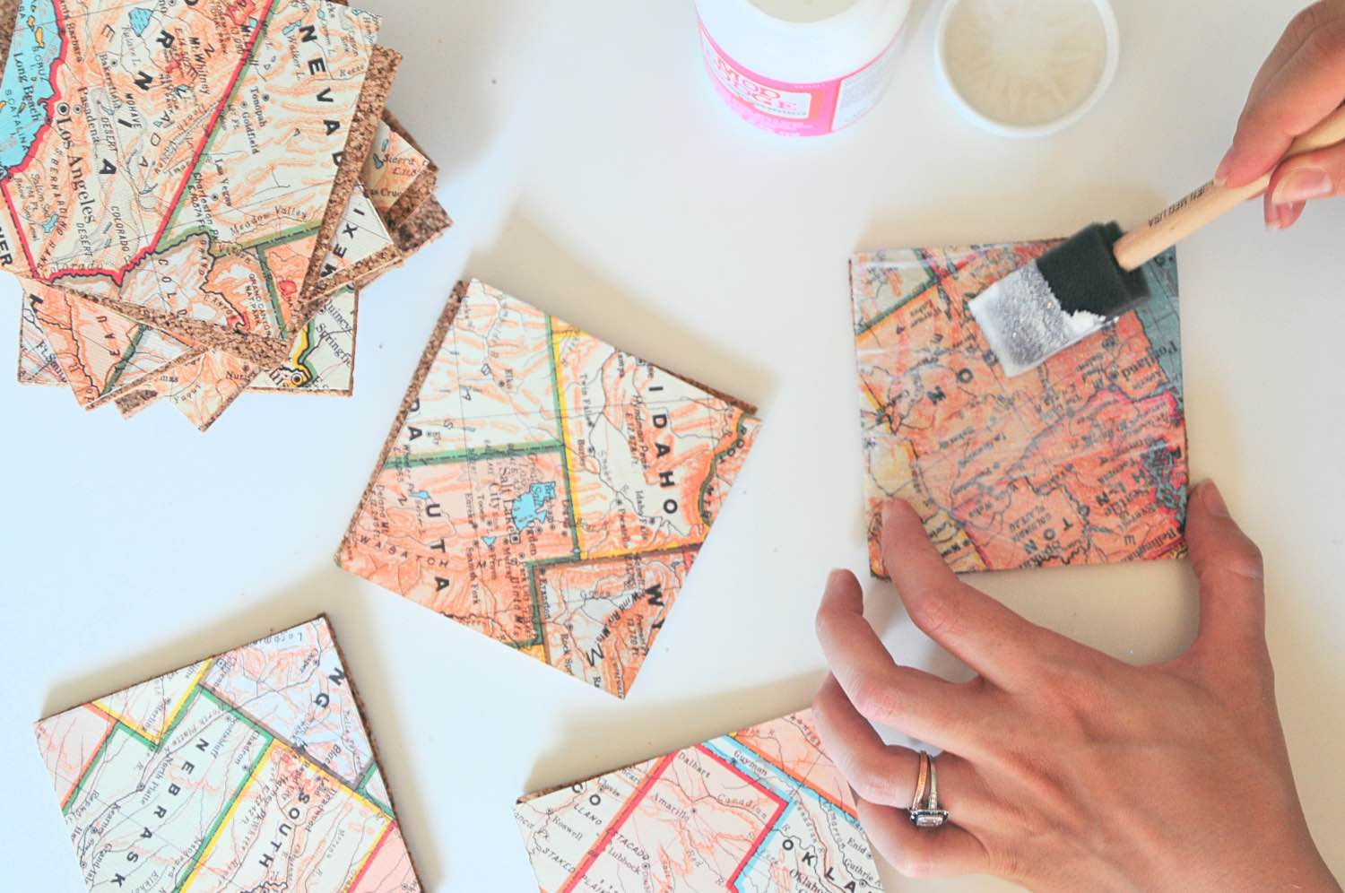 add mod podge to the map diy map coasters tutorial