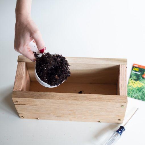 add-soil-to-the-diy-wood-planter-box-gardening-diy-tutorial_square