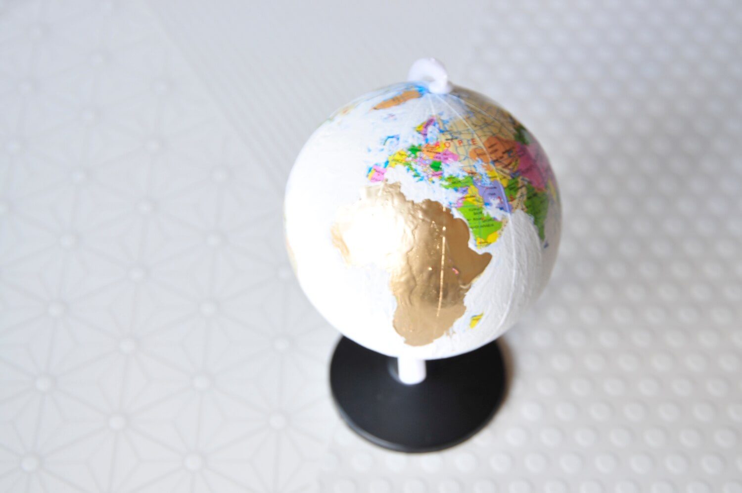 add the gold to the diy chalkboard painted globe craft in style
