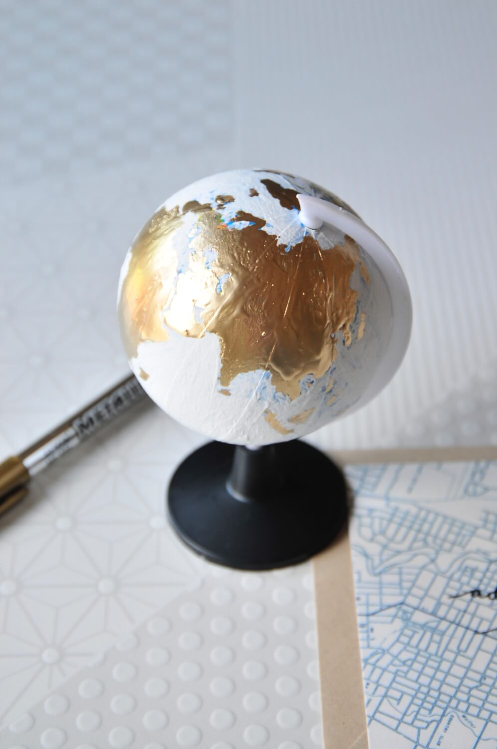 close up almost finished chalkboard painted globe pop shop america