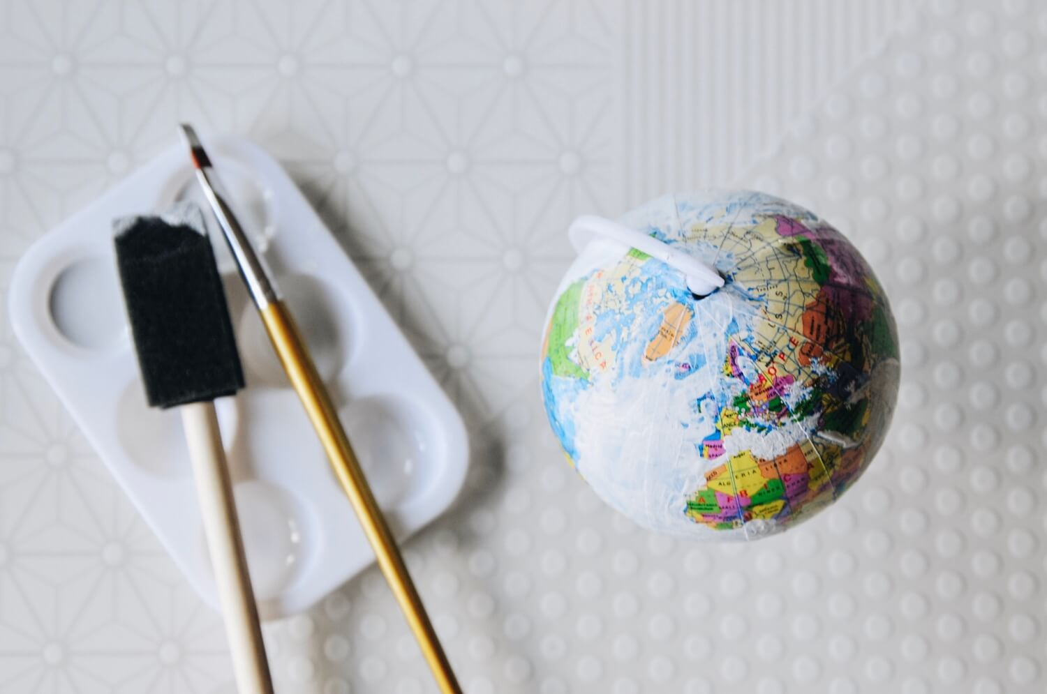 first coat of chalkboard paint - diy hand painted globe tutorial