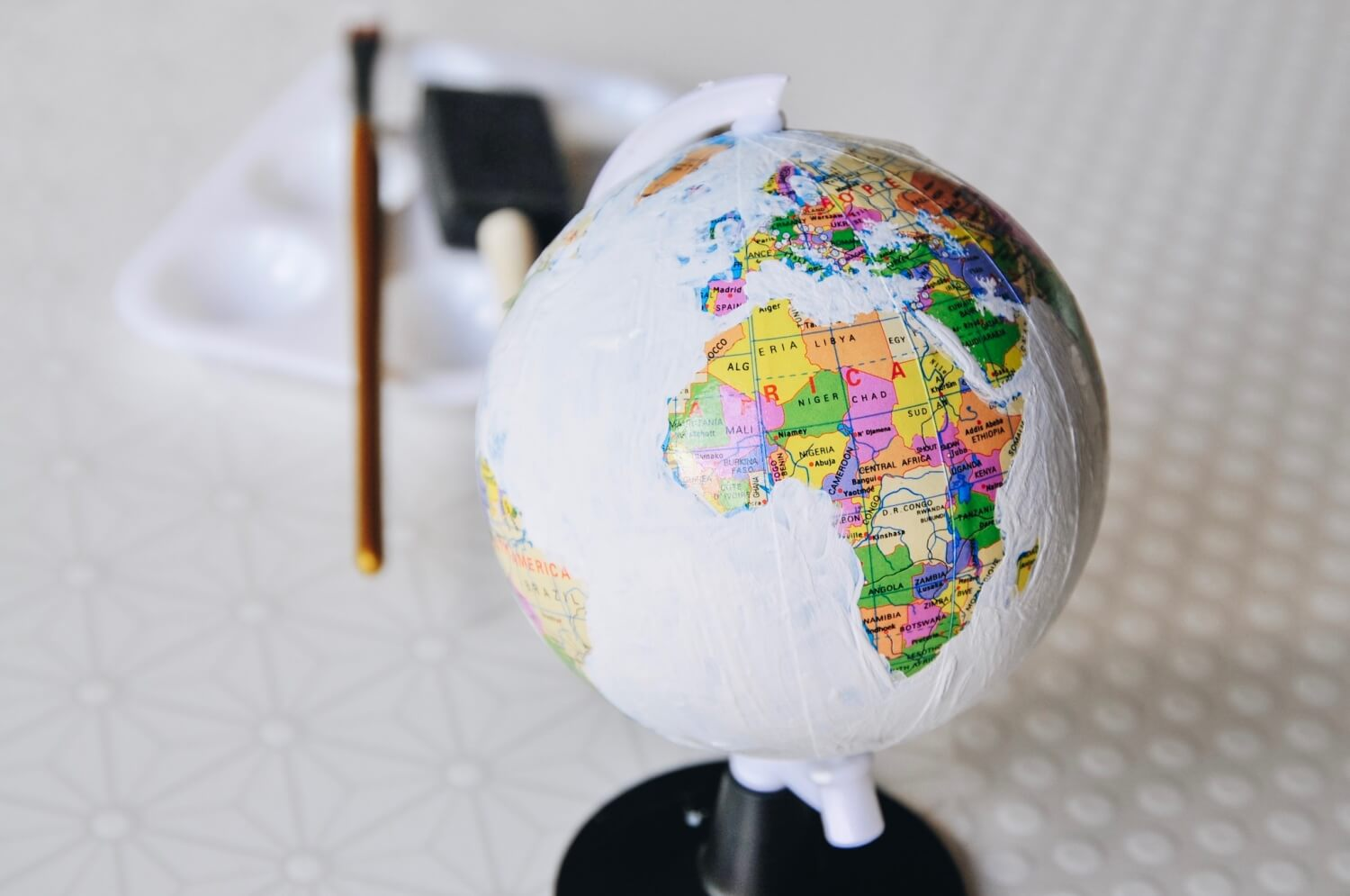 second coat of chalkboard paint - hand painted globe tutorial
