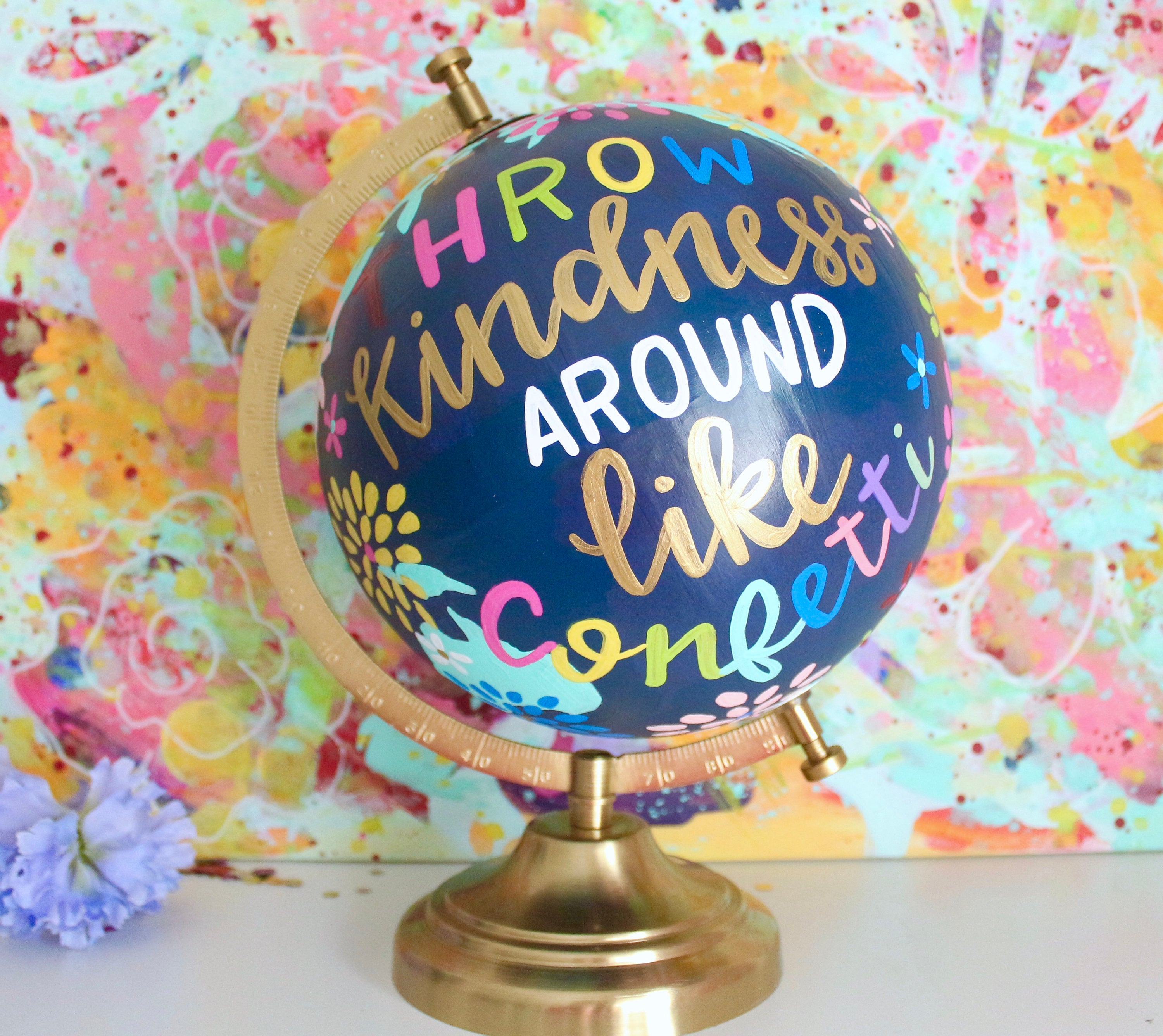 throw kindness around like confetti hand lettered globe