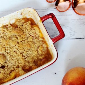 Angled-Peach-Vanilla-Bourbon-Crumble-with-Peach-and-Spoons_square
