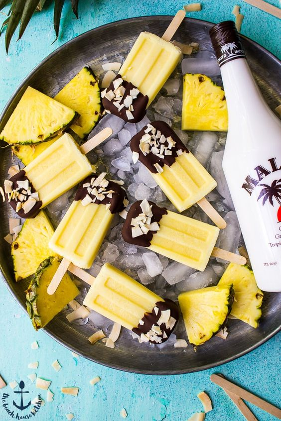 chocolate dipped pina colada popsicle with alcohol