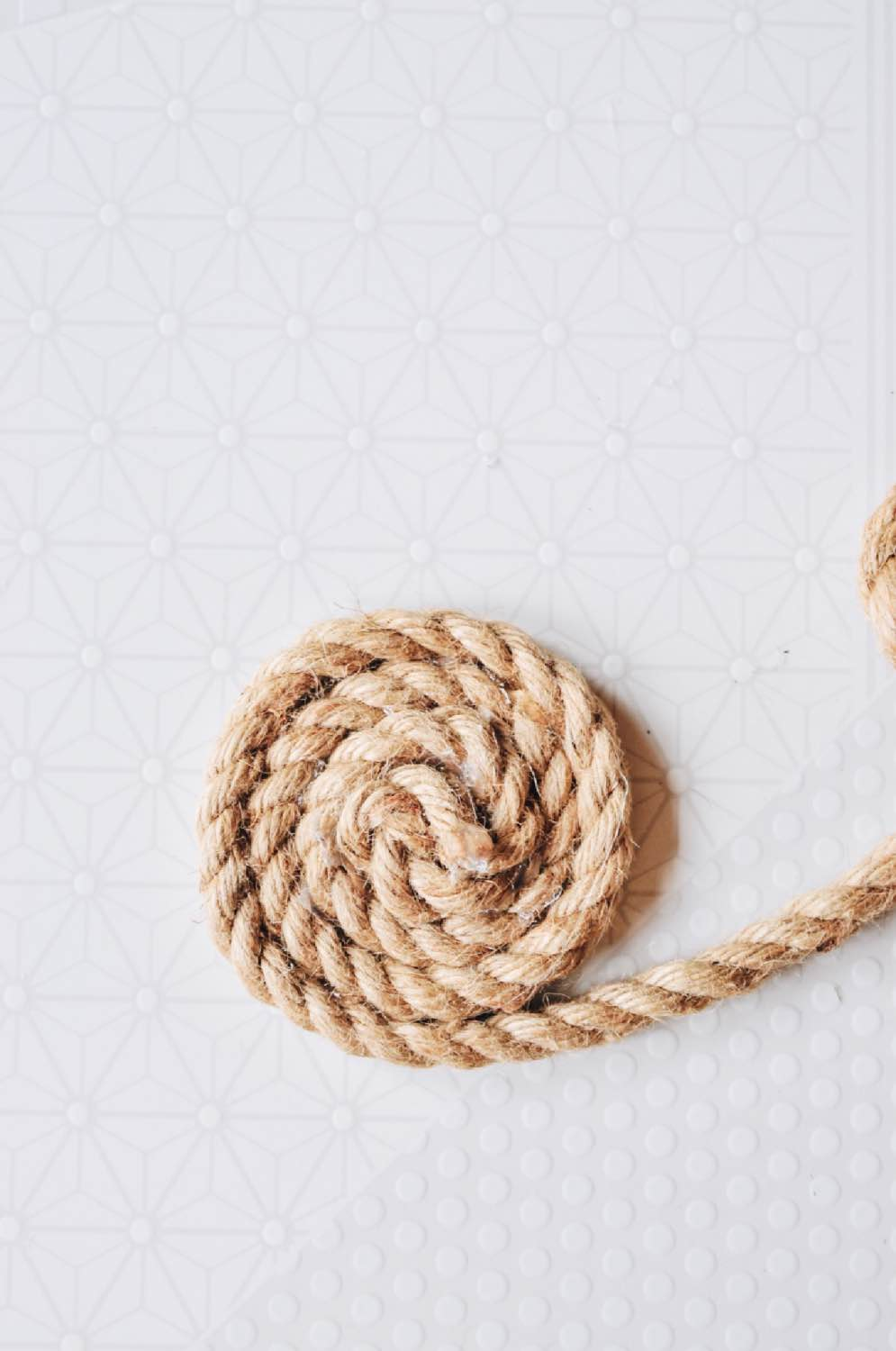 continue to wind the rope diy rope trivet craft tutorial