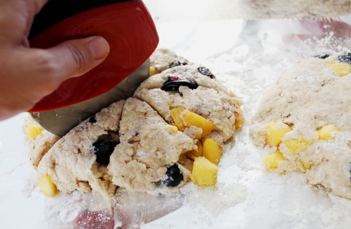 cut dough into 8 triangles for peach blueberry scones