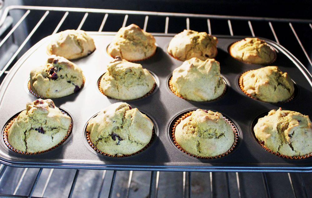 pumpkin cranberry walnut muffins baked in oven