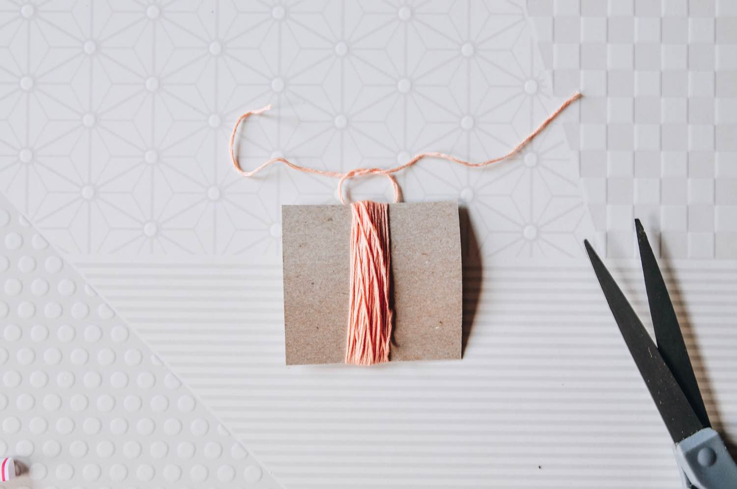 tie the embroidery floss in a knot pop shop america
