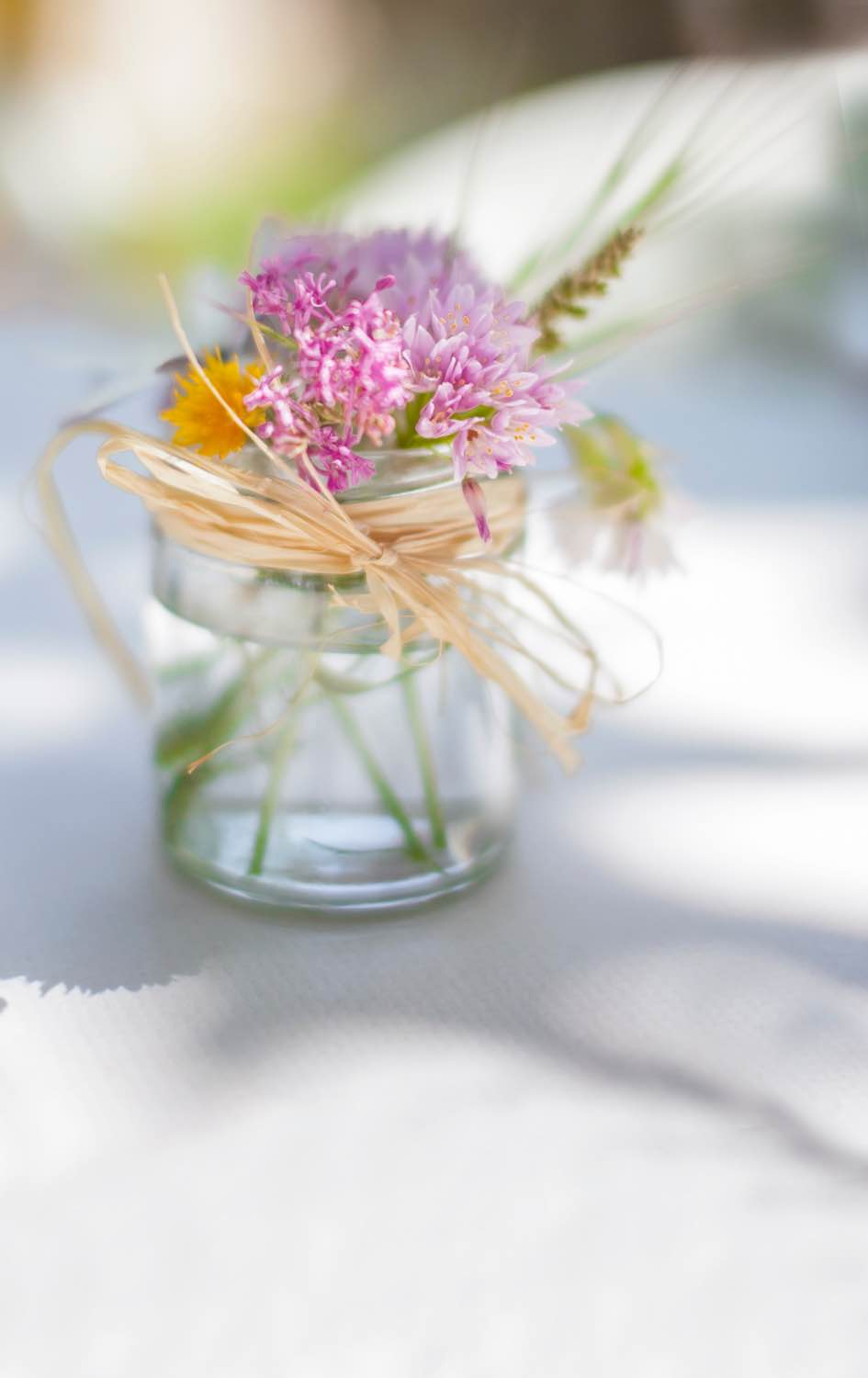 tiny pink flowers in a glass jar diy idea pop shop america