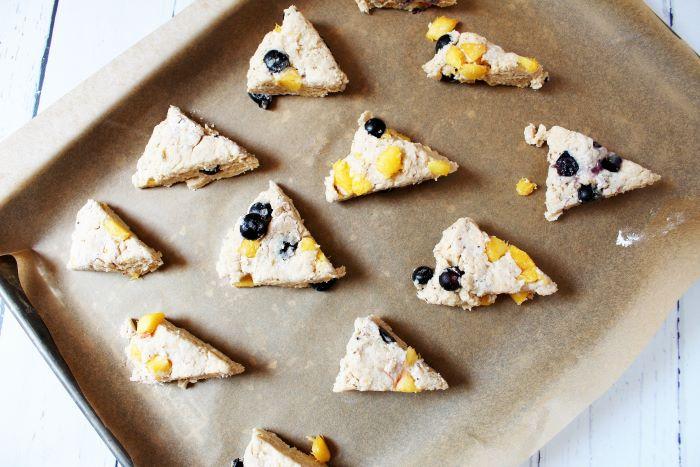 unbaked peach blueberry scones on baking sheet