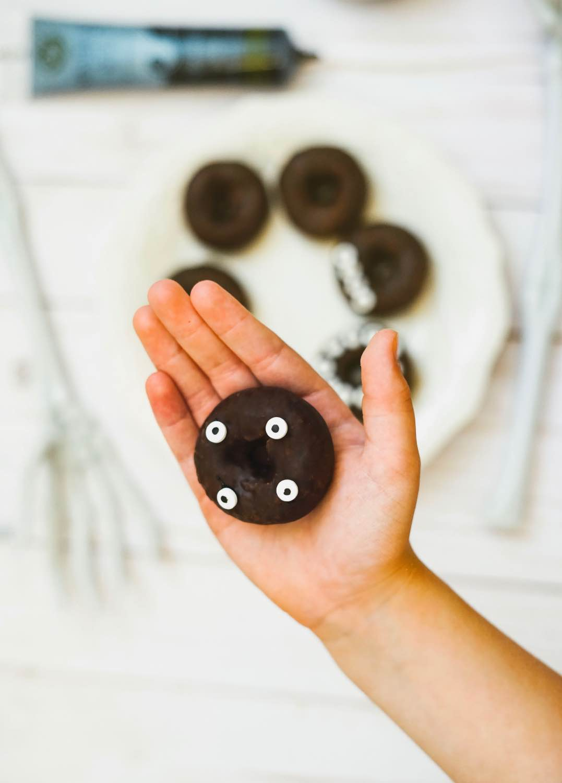 add candy eyeballs to the diy monster donuts halloween dessert