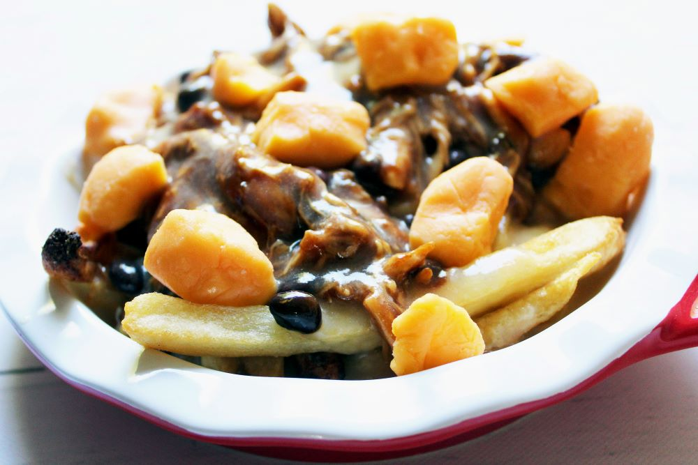 angled view of bbq chicken black bean poutine