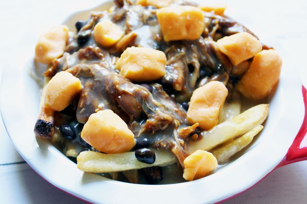 bbq chicken black bean poutine topped with cheese curds