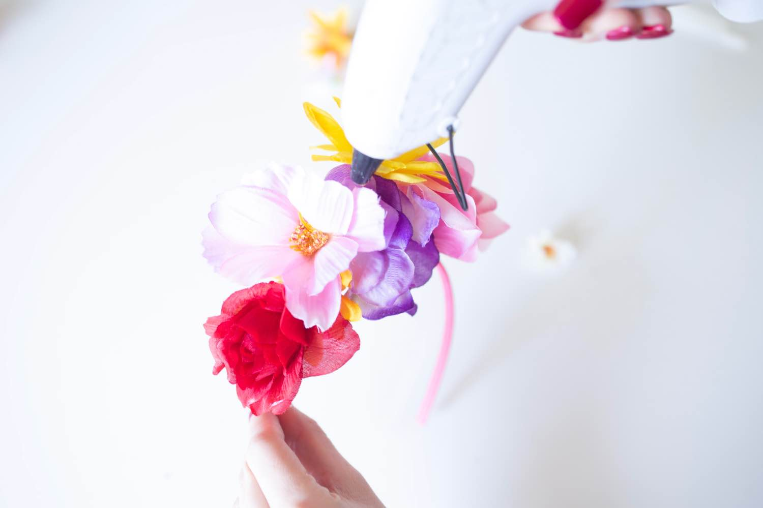 layering flowers to make a rainbow flower crown diy