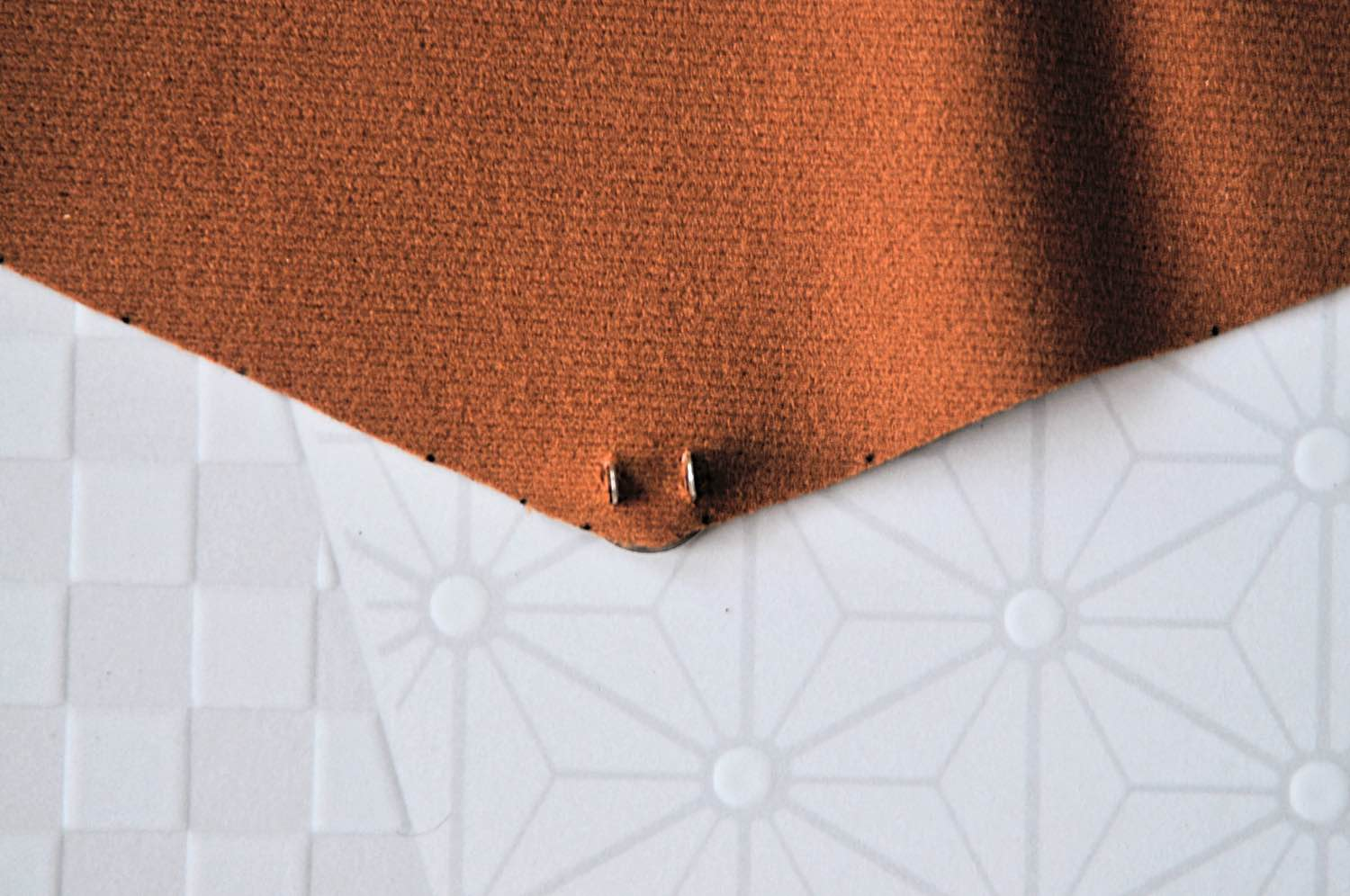 poke the clasp through the leather diy no sew clutch