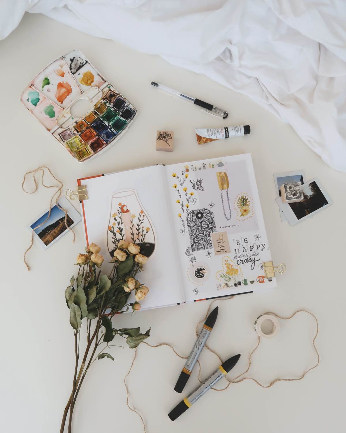 use watercolor, polaroids and other supplies to make a stylish bullet journal