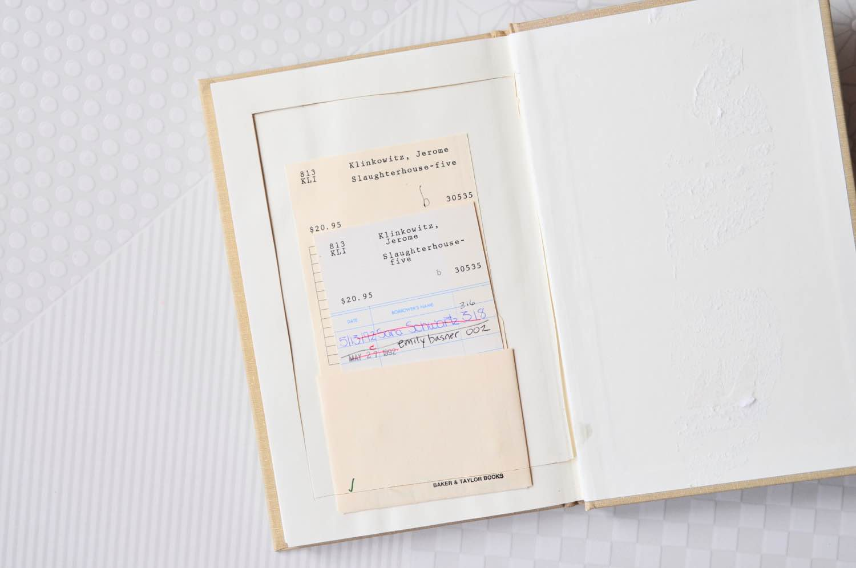 cut the inside book pages to make a book clutch pop shop america