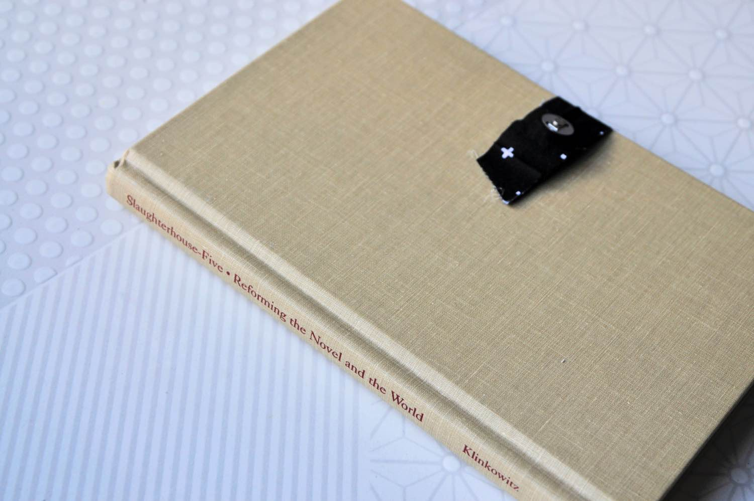 side of the book clutch with metal clasp pop shop america