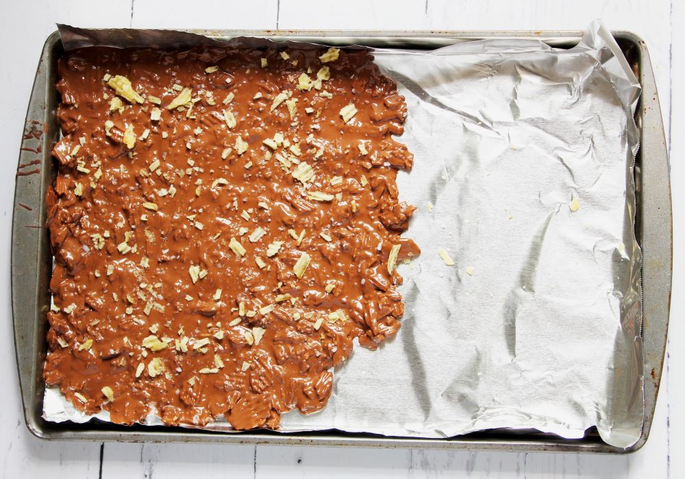 chocolate potato chip bark spread sprinkled with crushed chips 1