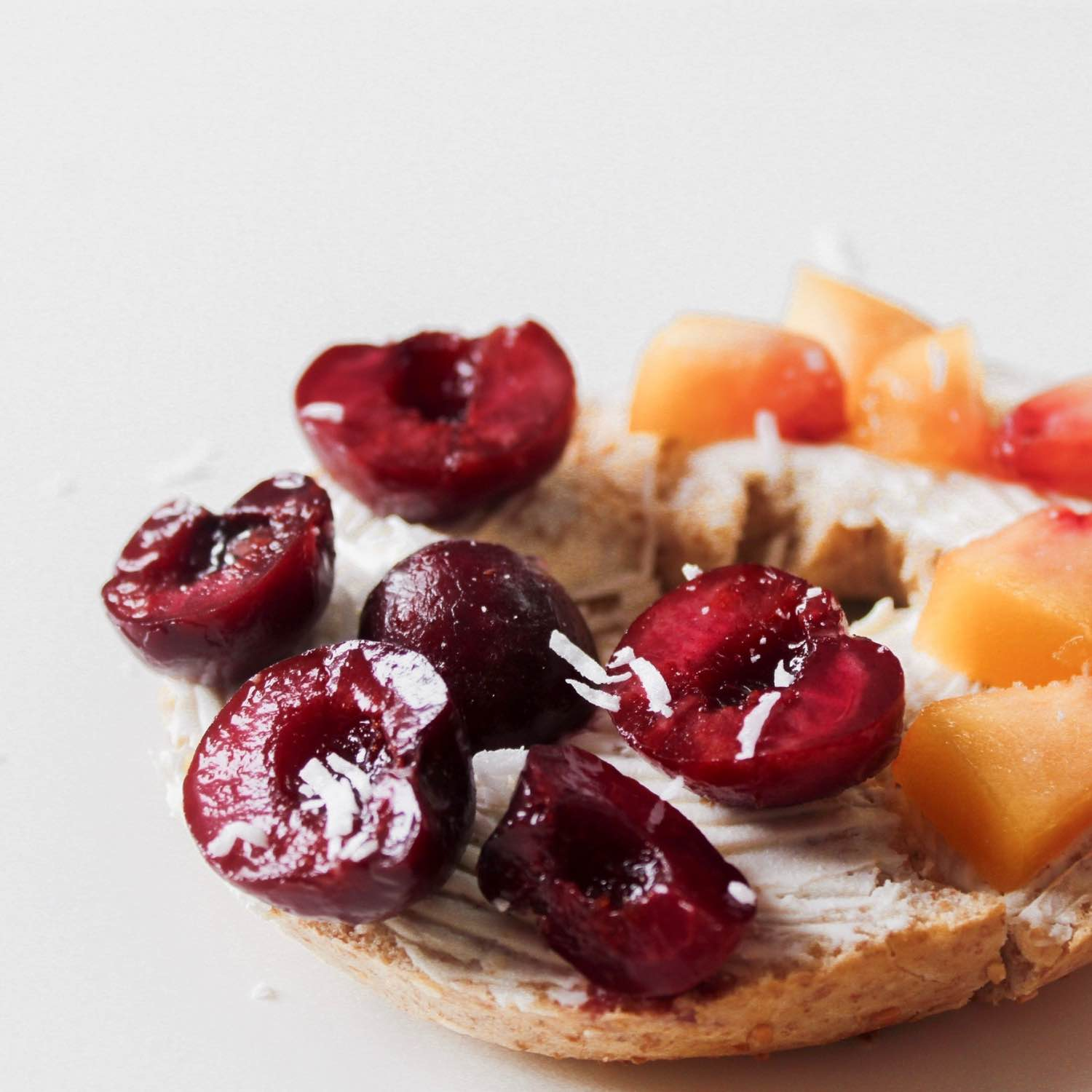 close up with rainbow fruit topped bagel easy recipe
