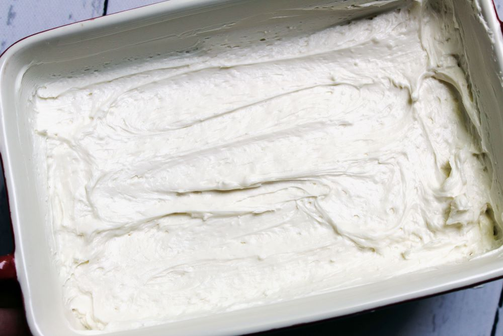 goat cheese spread in the baking pan