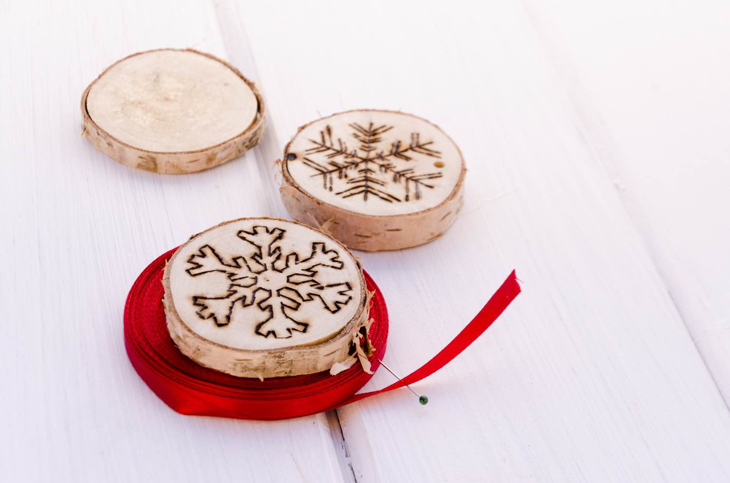 string wood burned ornaments with holiday ribbon pop shop america