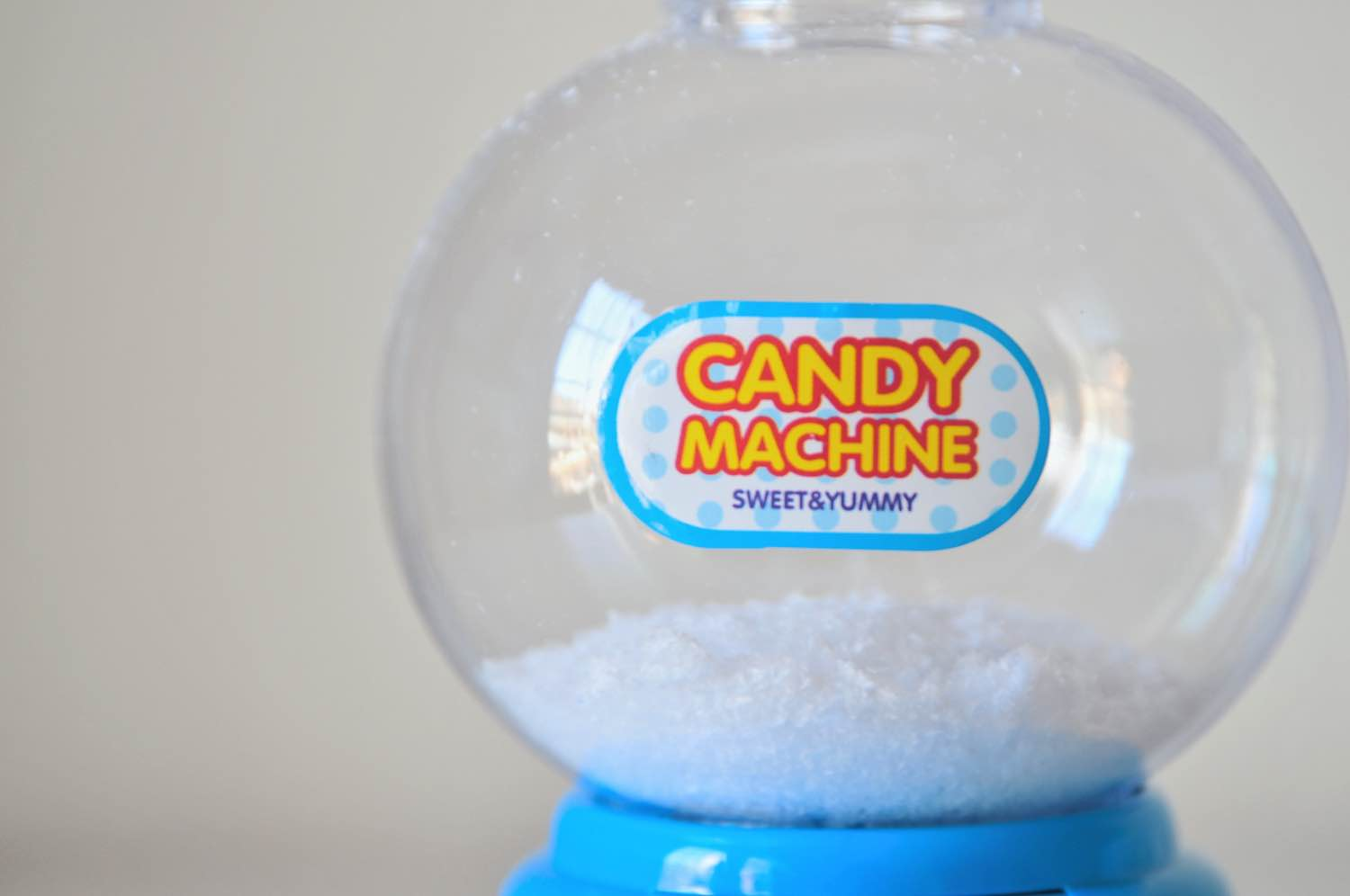 add faux snow to a gumball machine snow globe
