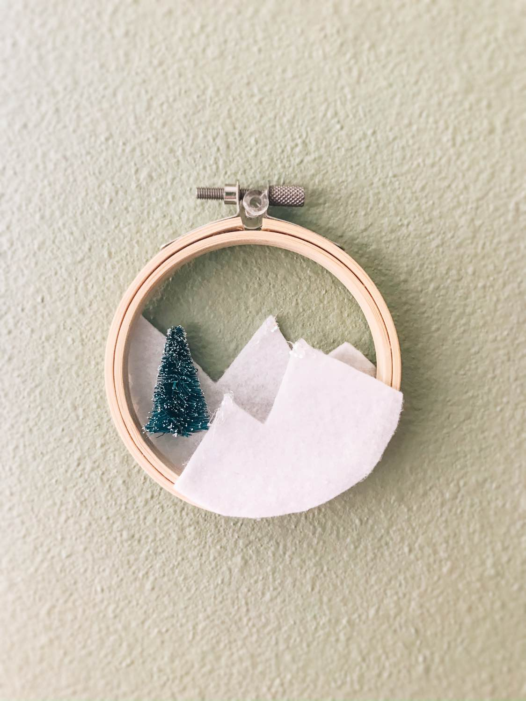 hanging the diy embroidery hoop wreath craft tutorial