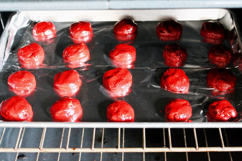 cookie dough in oven to make red velvet cookies 1