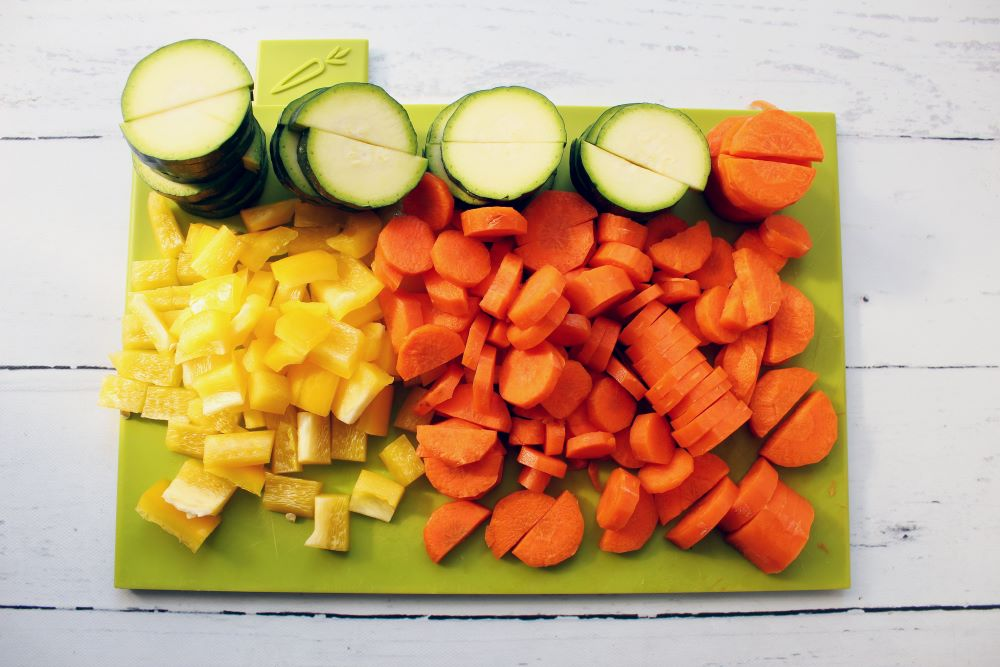 veggies on cutting board for turmeric chicken skillet 1