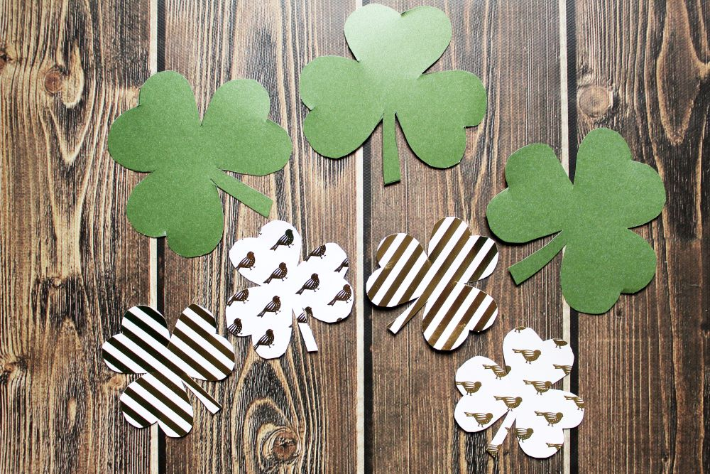 cut out shamrocks for diy st patricks day garland banner 1