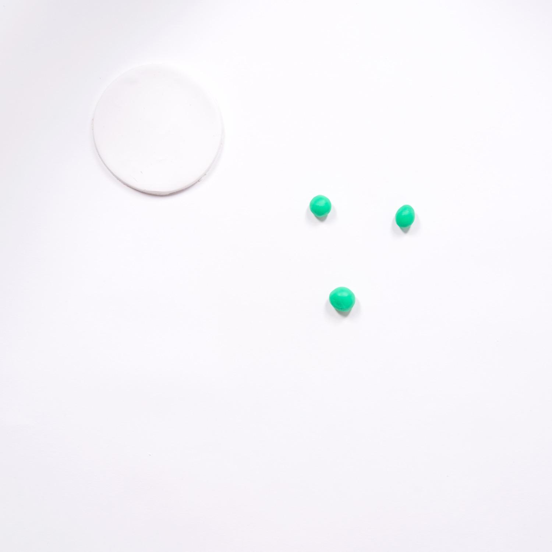 roll green into small balls then flatten it pop shop america