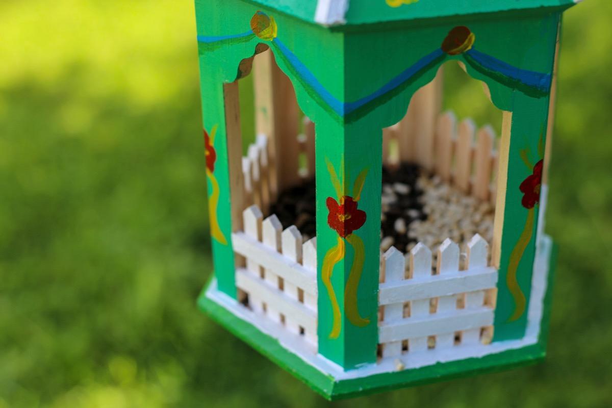 add bird seed to the bird feeder diy pop shop america