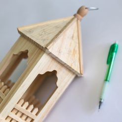 pencil the sides of the wooden birdhouse to paint it