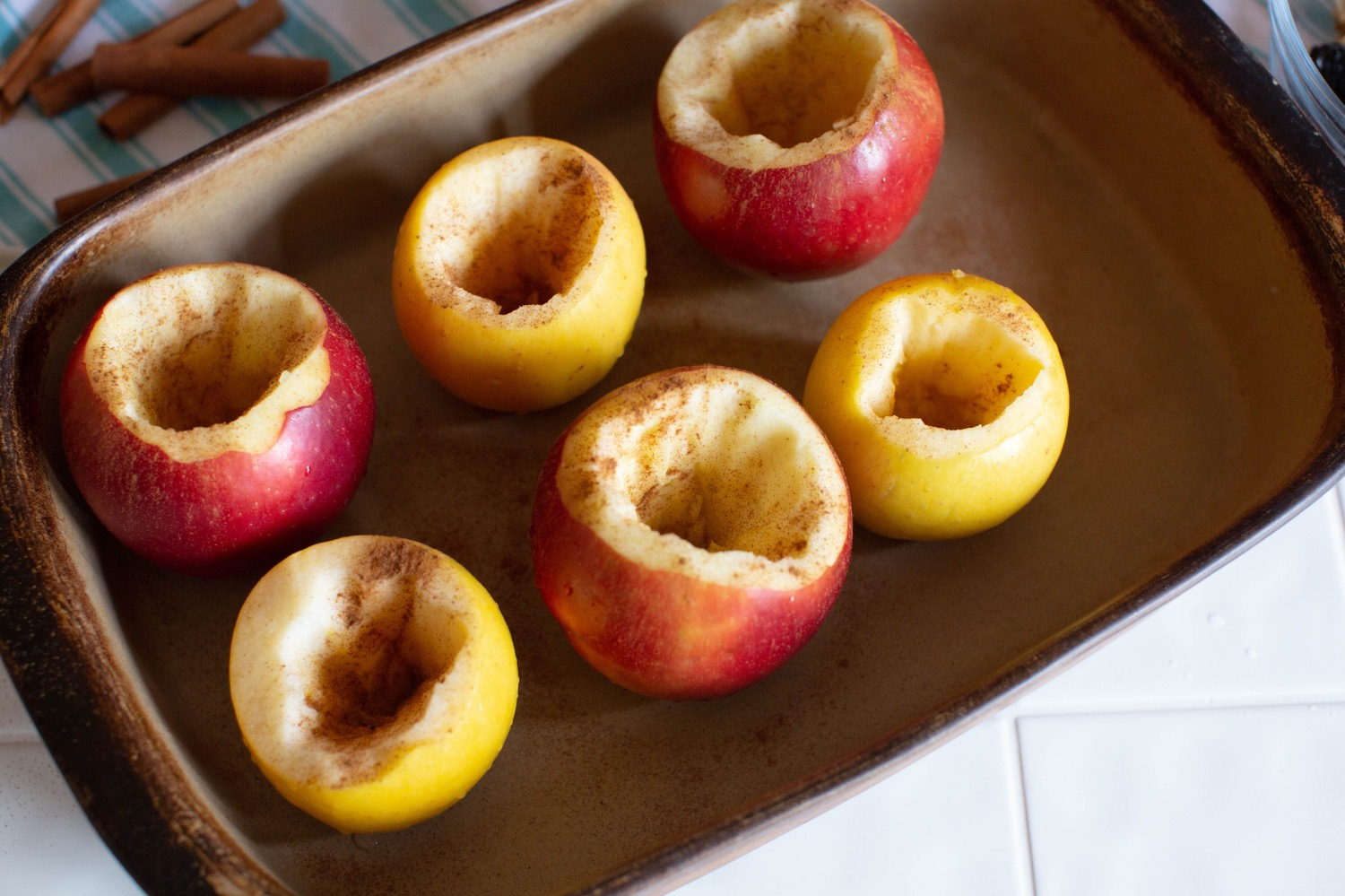 sprinkle hollow baked apples with cinnamon