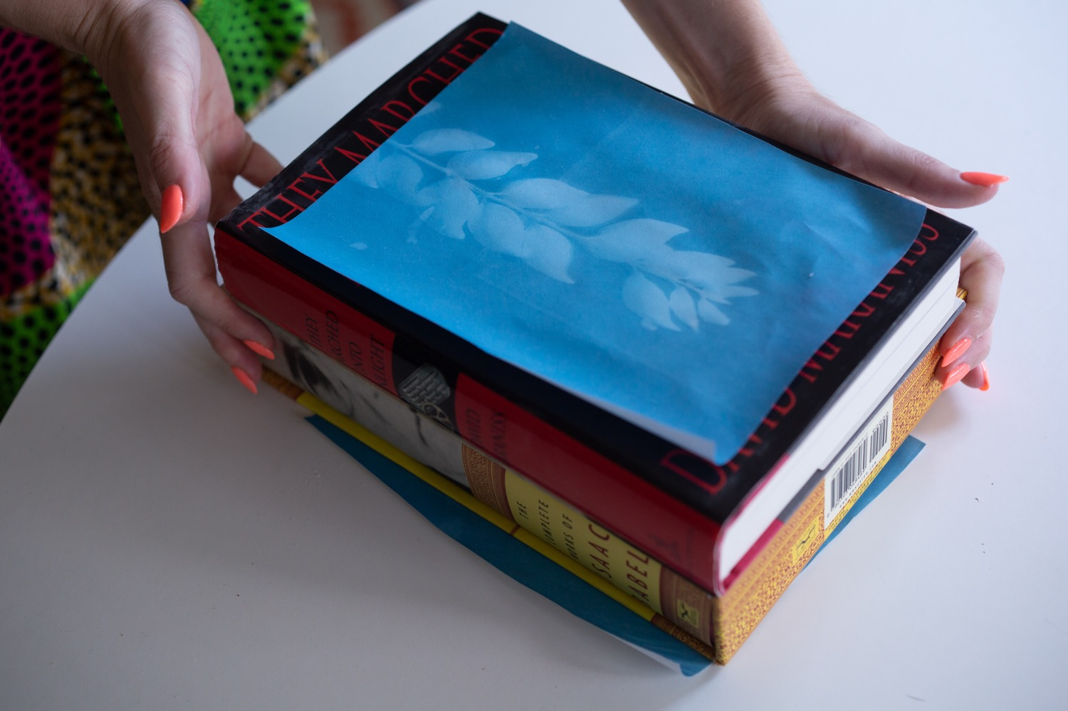 flatten photo paper by placing it underneath books
