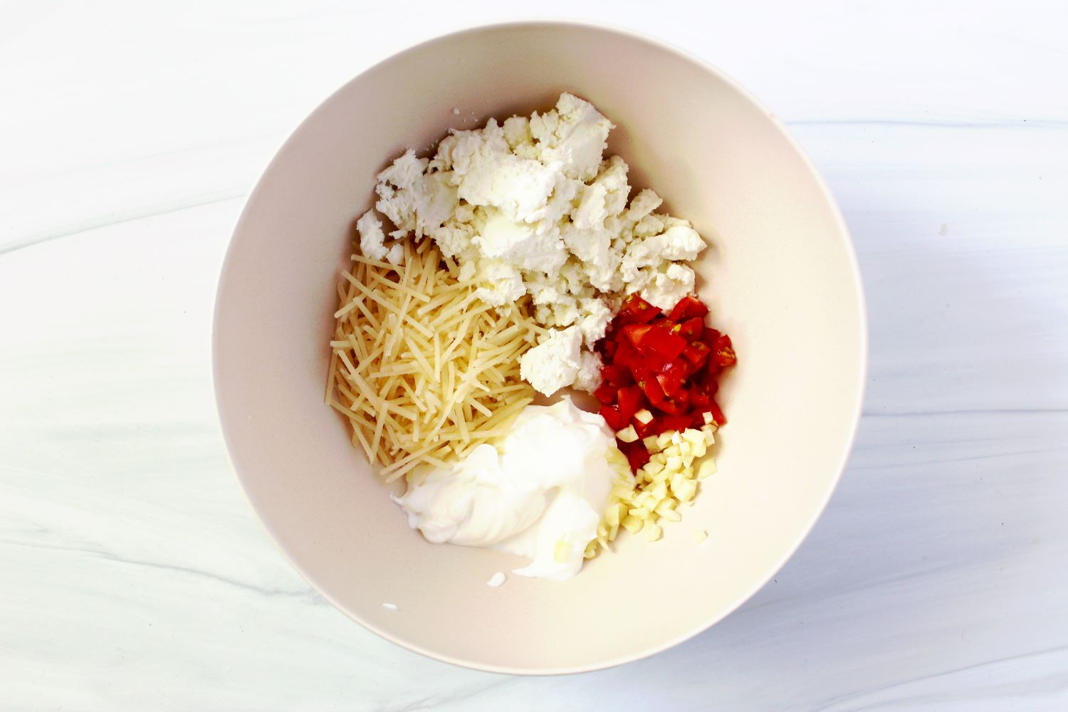 goat cheese and parmesan and tomatoes in bowl for air fryer stuffed jalapenos 1