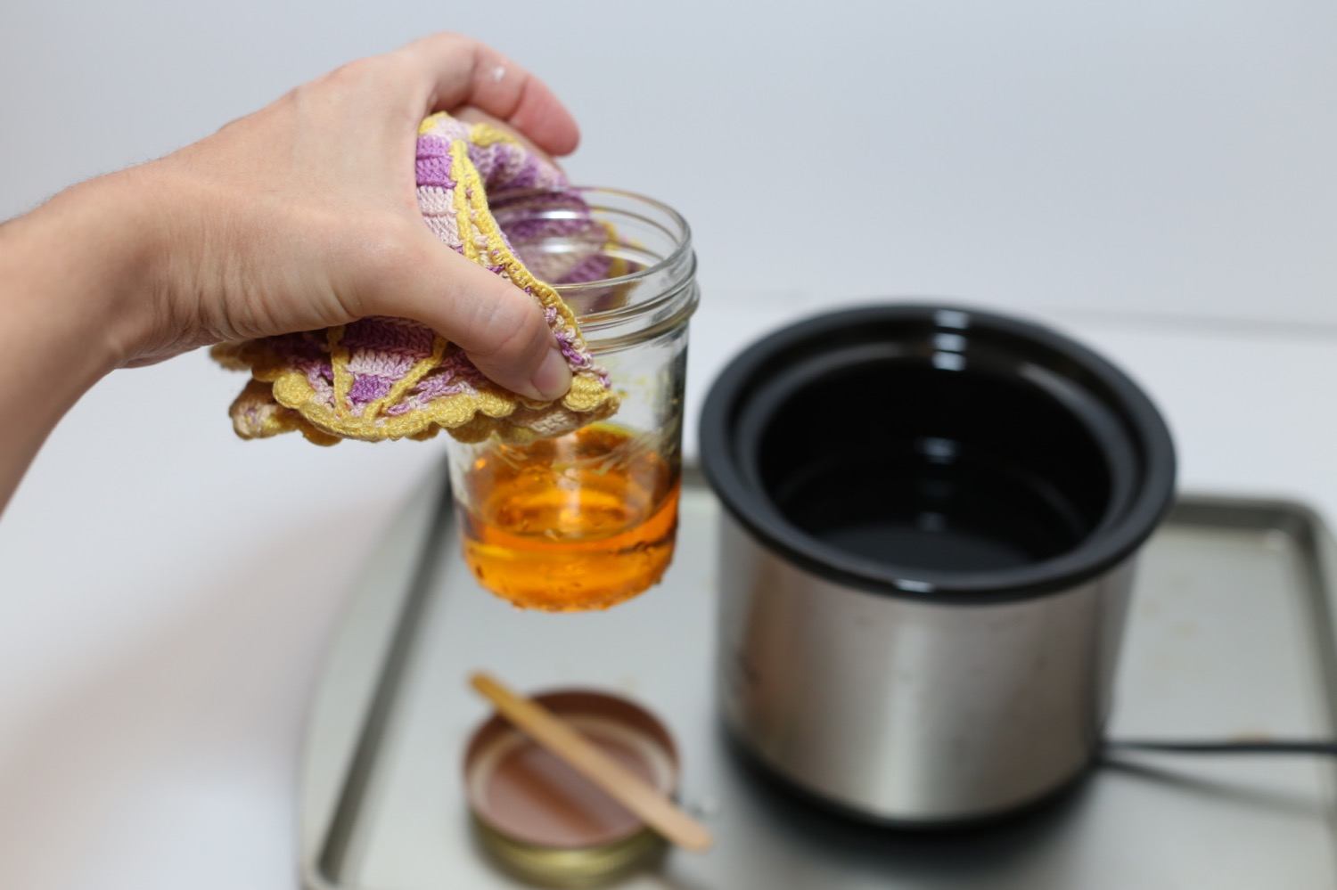 remove the mason jar and wax from the heat