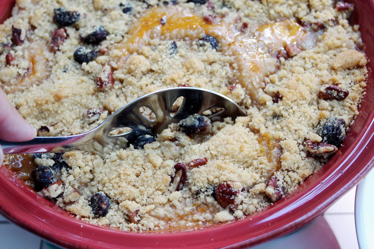 closeup spoon in cranberry pumpkin crumble 1