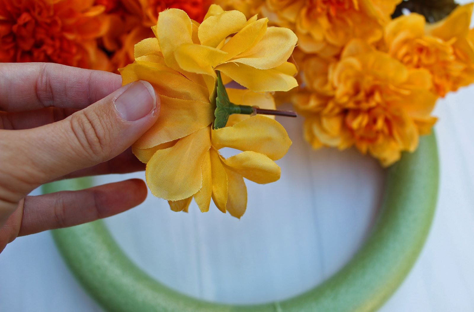 cut floral stems to stick in diy wreath 1
