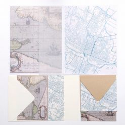 flatlay of map stationery paper set
