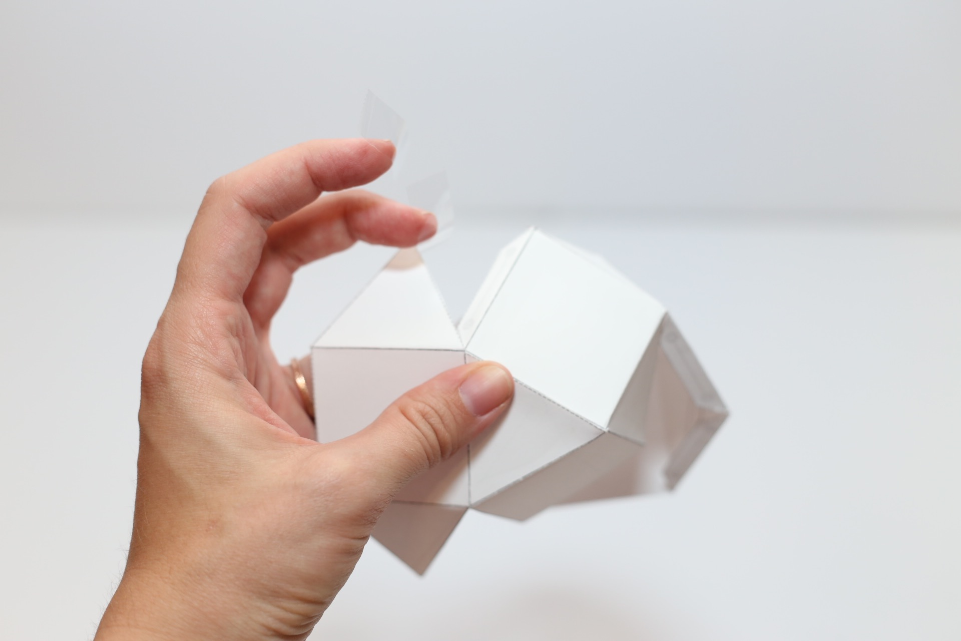 folding the edges of the geometric candles