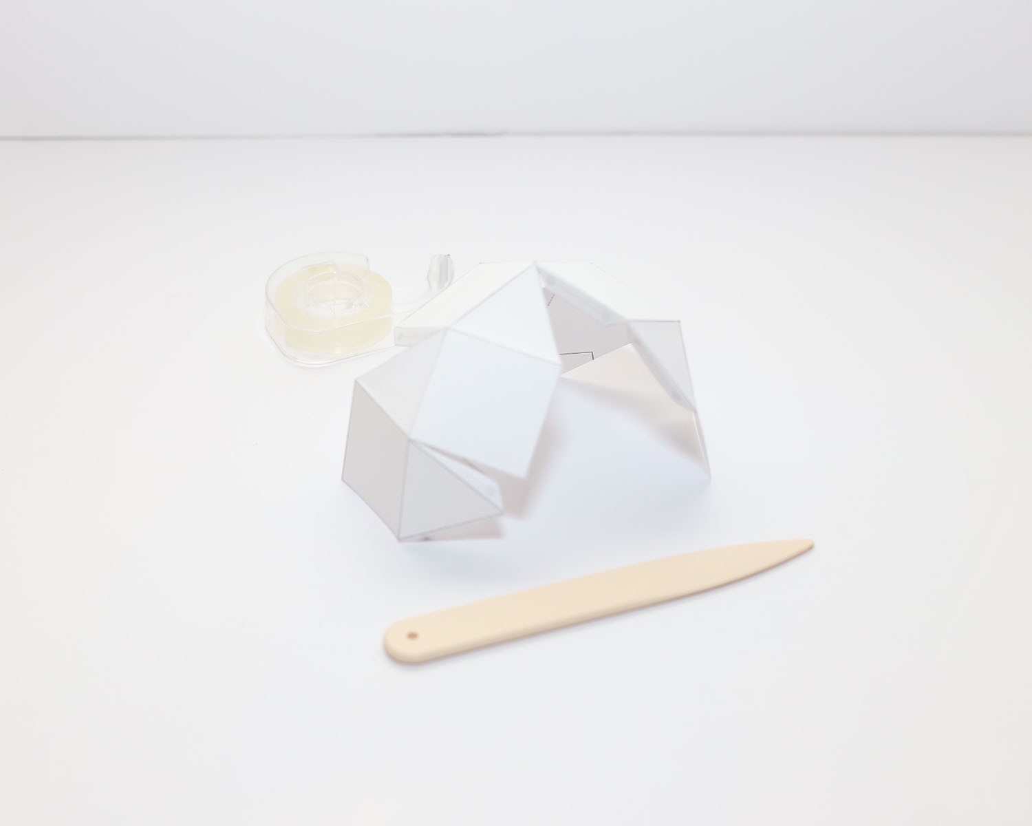 folding the geometric paper template for candle making