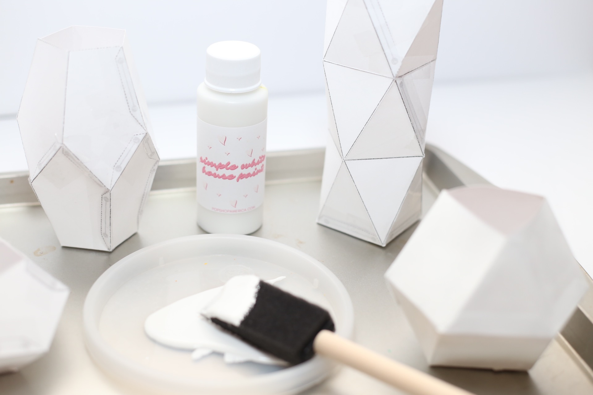 paint the geometric candles with house paint