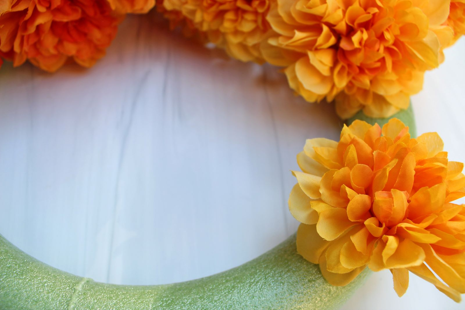 sticking flower stem into foam wreath ring 1